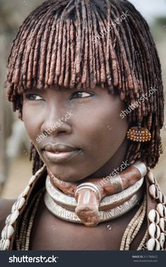 TURMI, ETHIOPIA - 12 AUGUST: portrait of unidentified Hamer tribe woman, Omo valley, 12 august 2014. Hamer woman usually comb their hairs with soil