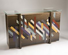patternity - the phase sideboard: lovely piece of furniture with geometric designs, a good combination of color, and gorgeous wood