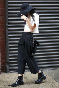 Women's spring fashion black wide brim hat+white boxy bare midriff crop top+wide leg pants