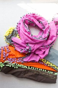 bright scarfs with pompom trim