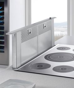 Downdraft Ventilation for Cooktops & Stovetops. This is Thermador, but there are several different brands including one at Lowe's. Kitchen Fan, Kitchen Hoods, Kitchen Stove, Kitchen Appliances, Kitchen Cooktops, Kitchen Extractor Fan, Kitchen Ranges, Extractor Fans, Kitchen Ideas