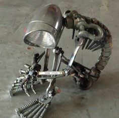 Headlight sculpture.  Not sure who made this  but I<3 it!  I need to learn to weld!  :)