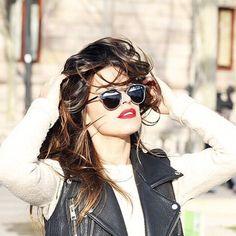 Dulceida wears a leather biker waistcoat and black sunglasses | Fashiolista.com