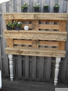 Use part of a pallet to make narrow shelves for plants - I like how they have them here with old chair or table legs.