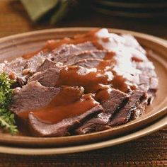 Slow Cooker Sauerbraten Recipe~ Normally it takes 5 days to marinate the roast (you have to turn it every day) and that takes some planning. But this iis one of my favorite German recipes (I'm mostly of German descent). I grew up eating German food and learned from my Gramma how to make all the old country dishes. My husband hates German food *thunks head on table* D'oh!!!!!
