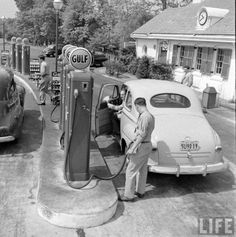 a '46 Ford Deluxe @ a Gulf Gas Station