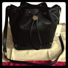 SALE⚡️NWT Tory Burch Robinson Saffiano Bucket Bag Price is firm! Brand New Tory Burch saffiano leather bucket bag with tags attached.  Pale golden hardware.  Adjustable shoulder strap.  Drawstring top with double-T logo.  Belted straps at bottom front.  Inside, fabric lining and zip pocket. Tory Burch Bags Crossbody Bags
