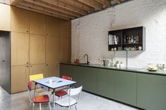 Green cabinets in a modern house in Antwerp by Belgium-based Made Architects.