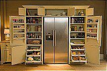 Amazing pantry built around fridge
