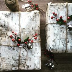 Birch bark paper and touches of greenery and berries.