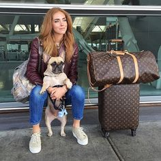 When you have a furry travel companion, you'll want an outfit that won't require too much attention so you can focus on your pal. Take a cue from Chiara Ferragni and pack all the essentials into an eye-catching backpack. A colorful leather jacket and denim ties the whole look together.