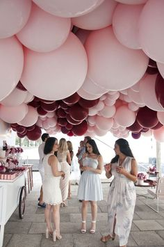 Balloon Installations As Wedding Decor ~ pink and burgundy balloon cloud by Belle Balloons