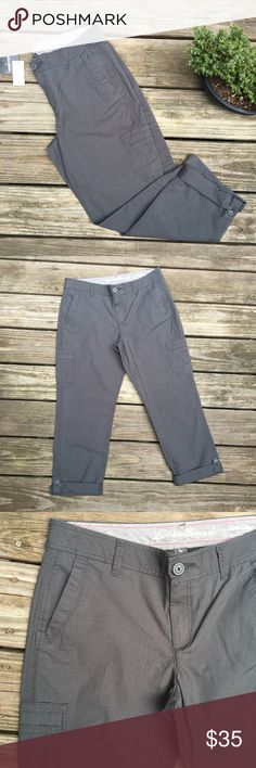 """NWT Eddie Bauer Capris Gray Crop """"Slightly Curvy"""" These charcoal gray capris are brand new with tags. Super-nice for the fall weather! I noticed a tiny white (scuff?) mark on them.....shown in last pic. It's not noticeable unless you are picking over it like I did haha. Beautiful crop pants that are slightly Curvy. Inseam: 27.75"""" (when legs are unrolled) Rise: 10"""". Waist: 16.5"""" Size 8. ~~Bundle and save!~~ Or shoot me an offer. NOTICE: If these look faded it's only because of the camera and…"""