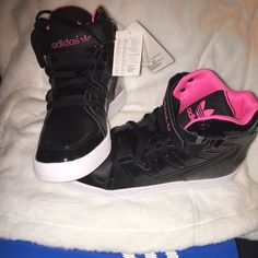 Adidas black high top tennis shoes -Women's Black with pink trim new in the box. NO TRADES Adidas Shoes Sneakers