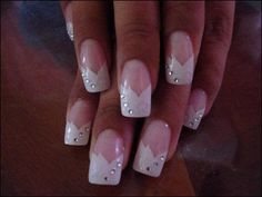 Beautiful white with shiny decorations manicure