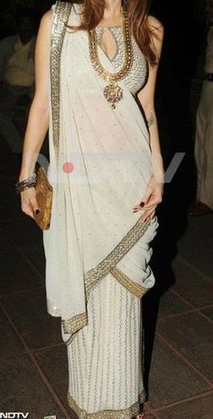 Nice way of styling your sari or saree with statement necklace. #IndianFashion