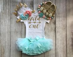 ***If you purchase the shoes, please leave a note to seller at checkout for the size you would like (see size chart in photos)*** This listing is for a Wild One Girls First Birthday Outfit in Peach and Aqua/Mint with a choice of Tutu Bloomers, Flower Headband, Bubblegum Necklace and