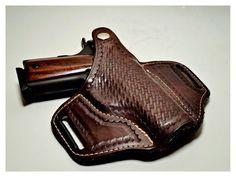 Handmade Leather Gun Holster For A Rock Island .45 speedloader now!  http://www.amazon.com/shops/raeind