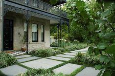 A stately Victorian era mansion and garden in Melbourne by Eckersley Garden Architecture