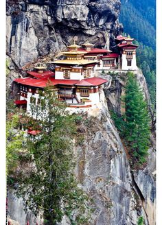 """Visitors to Taktshang are more likely to think that the monastery represents the victory of architecture over gravity. The seven separate temples that comprise the complex, the name of which translates to """"Tiger's Nest,"""" cling improbably to a small outcropping in the cliff..The trek up to Taktshang involves a 700 meter (2,300 foot)"""