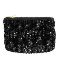 Small clutch bag with sequined embroidery at front, satin at back, and zip at top. Lined. Size 4 x 5 3/4 in.