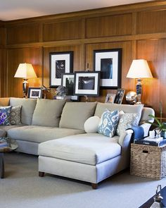 Living Room - A sectional sofa backed by framed photographs (Lonny)