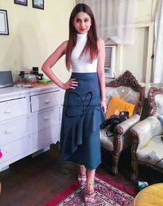 Long skirt with high neck white shirt