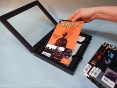 Make a display frame that can hold up to 10 comic books!