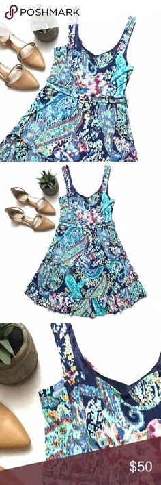 FREE PEOPLE Abstract Watercolor Dress FREE PEOPLE Abstract Watercolor Dress size small. Sleeveless. Slinky material. Lined. Double layered skirt. Perfect summer dress! Free People Dresses