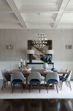 Fabulous deep panelled ceiling, dark wood floor contrasts muted grey tones.