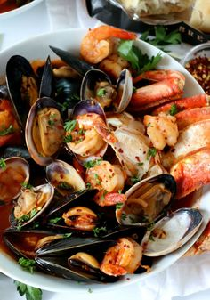 Spicy Shrimp Cioppino is the most soul warming, comforting and overall impressive meal you can make for a gathering, dinner party or holiday. Seafood Stew, Seafood Dinner, Seafood Cioppino, Soup Recipes, Cooking Recipes, Healthy Recipes, Bread Recipes, Cioppino Recipe, Shellfish Recipes