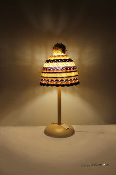 """Funky Fitting of the week.....is this rather cosy looking table lamp called """"Light-cap"""" by Adriana Gromnyuk, via Behance"""