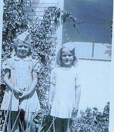 Lila and Joanne Burch wearing Air Force caps given by airmen from Davis Monthan Air Force Base, Tucson, AZ. circa 1943