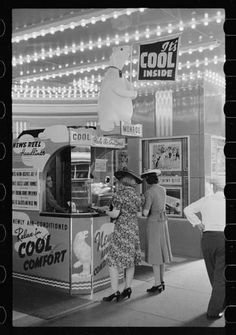Women standing in front of a ticket booth at the Monroe Theater (in the loop), c.1940, Chicago