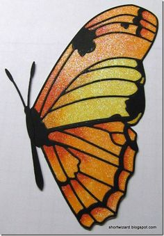 Memory Box Butterfly.  Glitter is applied and then colored with copics.  I can't wait to try this!!!
