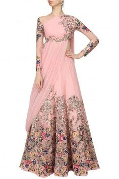This set features a pink lehenga skirt in net base with multicolor floral embroidered poatchwork highlighted with sequins embellishment on the ghera and sleeves. It is paired with matching pink floral embroidered net blouse with an attached dupatta. Indian Bridal Lehenga, Indian Gowns, Indian Attire, Indian Ethnic Wear, Pakistani Dresses, Indian Outfits, Indian Sarees, Pakistani Bridal, Salwar Kameez