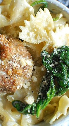 Italian Wedding Pasta - Bow tie pasta in a creamy cheese sauce, perfectly seasoned meatballs and fresh spinach - a bit like a stew and a bit like a pasta casserole with all the flavors you love in an Italian Wedding Soup. ❊