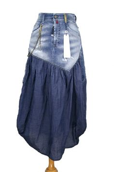 High 'Proudly' skirt in distressed denim and crisp cotton.
