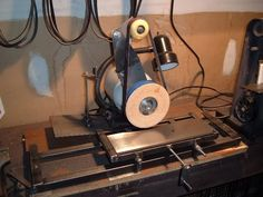 Surface Grinder by JADknives -- Homemade surface grinder adapted from a bench grinder and constructed from angle iron, threaded rod, wood, and steel. http://www.homemadetools.net/homemade-surface-grinder-2