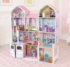 Young boys and girls are sure to love our brand new Country Estate Dollhouse. This deluxe wooden dollhouse is over 4 feet/122 cm tall and comes with 30 fun furniture pieces. There's even a deluxe porc