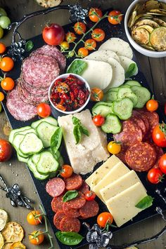 An amazing Summer Garden Antipasto Platter sure to impress at any house party!  Stock it full of summer veggies, cured meats, and cheeses!