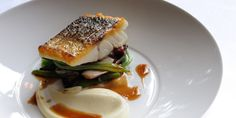 Escalope of wild sea bass with sautéed smoked bacon, red chicory, runner beans and red wine sauce