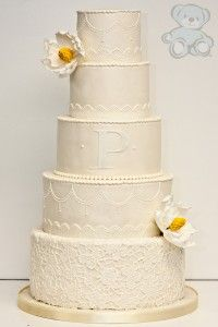 Ivory Monogram, Lace Wedding Cake with Fondant from Dream Day Cakes.