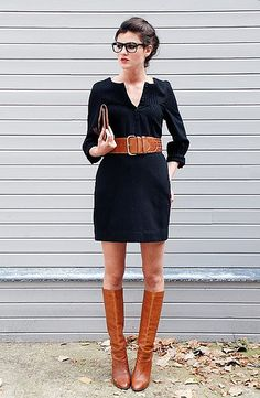 Great fall office wear when you pair a dark dress, long brown boots and a statement belt.