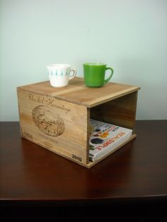 I could do that French Wine Crate Magazine Rack - Trash Can - Planter - Wall Mount or Table Top via Etsy.