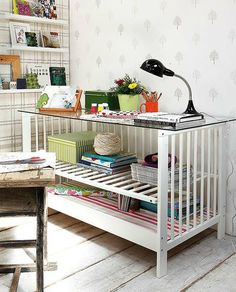 When you are done having little ones - re-design your cot into a work space?! Cute as a button!