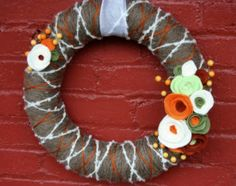 Since I made so many felt flowers for my wedding, why not continue by making a Fall wreath?  :)  DIY fall wreath--yarn and felt flower wreath from Home Stories A to Z blog