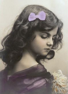 Beautiful young girl with bow in her hair Vintage Postcard.