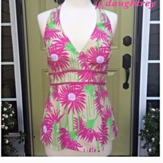 """Lilly Pulitzer Top Straw Coastal Kiss Print Beautiful floral print halter top from Lilly. Top is lined and it is 96% cotton and 4% spandex. Bust measures 30"""" and length from under arm is 16"""" plus halter ties. Cold wash and hang to dry. All measurements taken with top lying flat. Lilly Pulitzer Tops"""