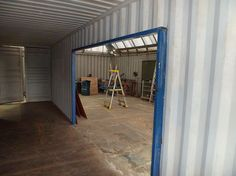 shipping container home construction large opening cut out and framed